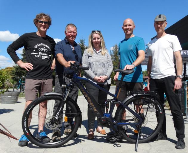 Moustache e-bike importer Campbell Read, of Queenstown, Stew Burt and Christina Perriam of the Canlive Charitable Trust, Mt Aspiring College teacher Andrew Sloane, and Matt Quirk of Good Rotations cycle shop, Wanaka, with the e-bike presented to Mr Sloane