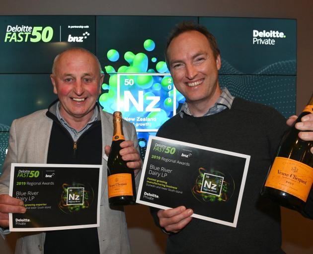 Blue River Dairy operations manager Rod Bott (left) and marketing manager Gareth Lyness celebrate at the recent Deloitte Fast 50 southern regional awards in Dunedin. Photo: Linda Robertson