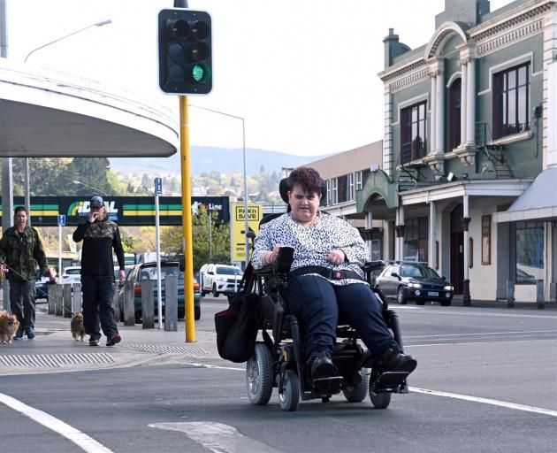 Wheelchair user Fiona Russell safely negotiates the crossing at Cargill's Corner in South Dunedin after the intersection was made much more accessible earlier this month. Photo: Linda Robertson