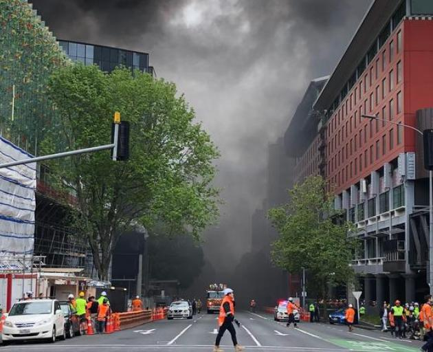 Smoke can be seen billowing in the air. Photo: RNZ