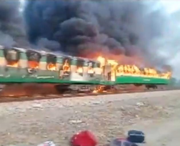 Video grab of a fire burning in a train carriage after a gas canister passengers were using to cook breakfast exploded. Screengrab: Reuters