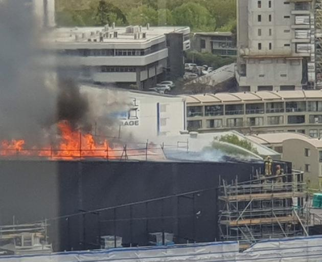 The top of the under construction SkyCity convention centre has been engulfed in flames. Photo:...