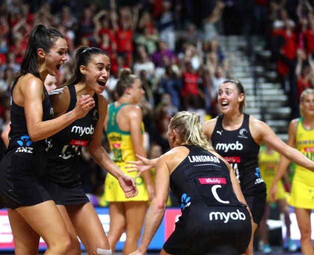 Ameliaranne Ekenasio, Maria Folau and Laura Landman of New Zealand celebrate after winning the...