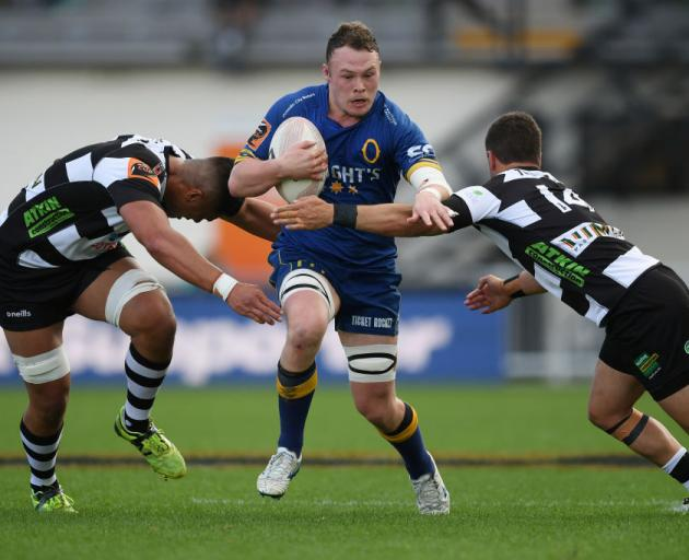 Otago flanker Slade McDowall tries to get between loose forward Marino Mikaele-Tu'u (left) and winger Caleb Makene in the semifinal against Hawke's Bay in Napier on Saturday. Photo: Getty Images