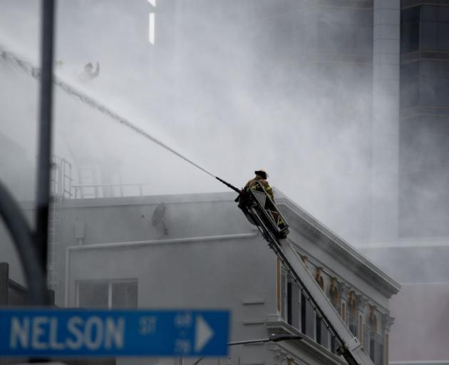 Firefghters continue to douse the roof as they battle the fire at the SkyCity Convention Centre...