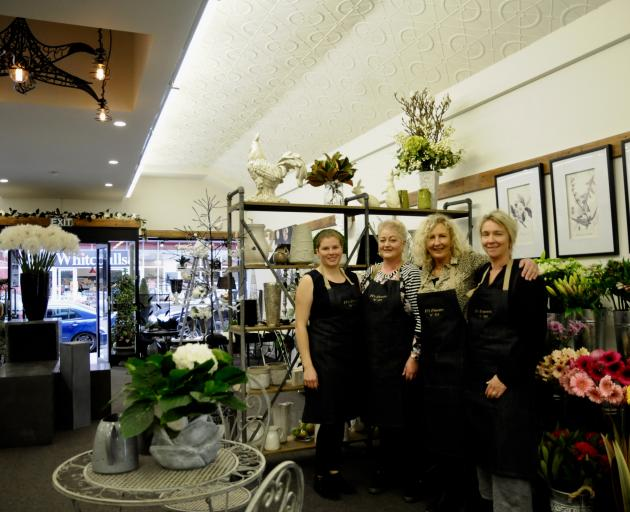 Fi Sidey, third from left, the owner of Fi's Flowers 'n' Art, with her staff, from left, Vivienne Williams, Roslyn Harris, and Sharon MacDonald. Photo: Shelley Topp