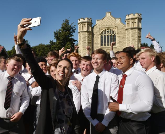 Prime Minister Jacinda Ardern takes a selfie with Waitaki Boys' High School pupils during a visit to the school in 2018. Photo: Gregor Richardson