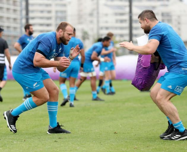 All Blacks prop Joe Moody prepares to make a tackle in training against Dane Coles. Photo: Getty...