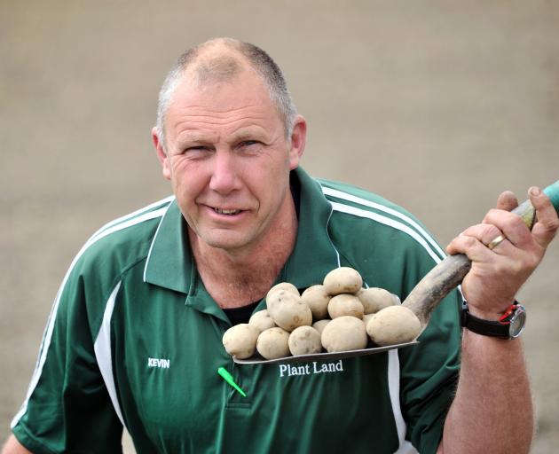 Wal's Plant Land garden consultant Kevin Lilley with some Jersey benne seed potatoes, now in...