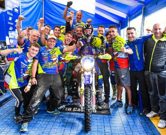 West Melton's Hamish Macdonald surrounded by family friends and team mates after his 125cc youth...