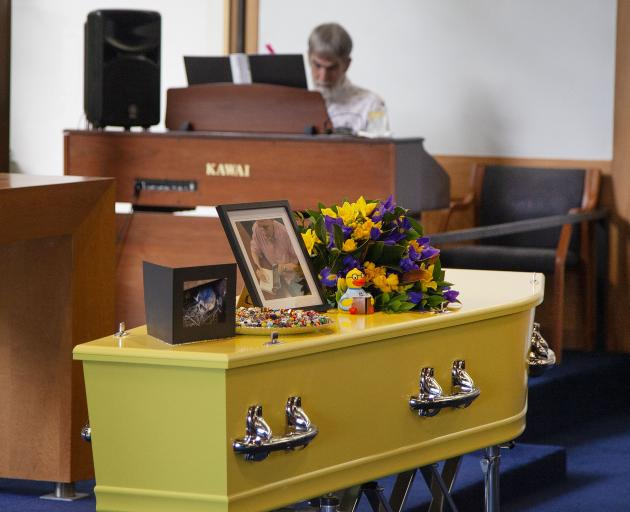 Funeral for Megan Hore - Richard Hore playing the organ.  PHOTO: GEOFF SLOAN