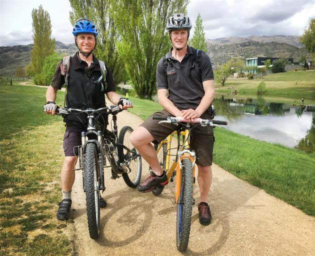 Central Otago Queenstown Trail Network project managers Tim Dennis (left) and David Howard put a section of the Lake Dunstan Cycle Trail at Pisa Moorings to the test on Monday afternoon. Photo: Alexia Johnston