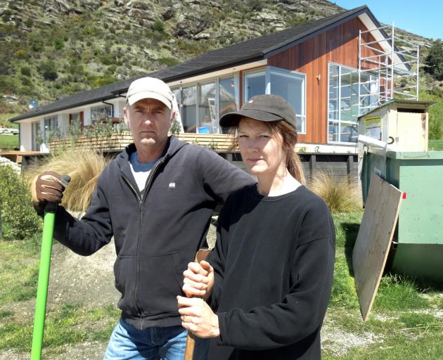 Disgruntled Queenstown home owners Tony and Rachel Windner outside their Kelvin Heights property, left unfinished when Fowler Homes Southern Lakes went into liquidation in March. Photo: Tracey Roxburgh