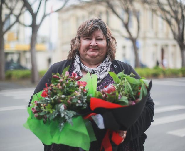 North Otago Floral Art Group president Colleen Waby gets ready to deliver flowers in Oamaru as part of the Lonely Bouquet project. Photo: Rebecca Ryan