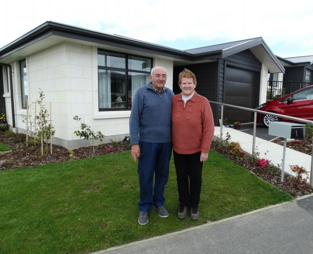 Trevor and Diane Dalton outside their two-bedroom villa at Observatory Village. PHOTO: DANIEL...