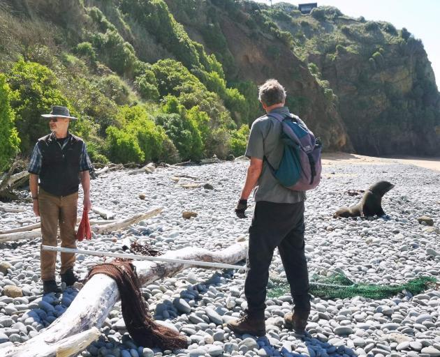 Former Department of Conservation ranger Derek Cox, of Oamaru, (left) and Doc biodiversity ranger...