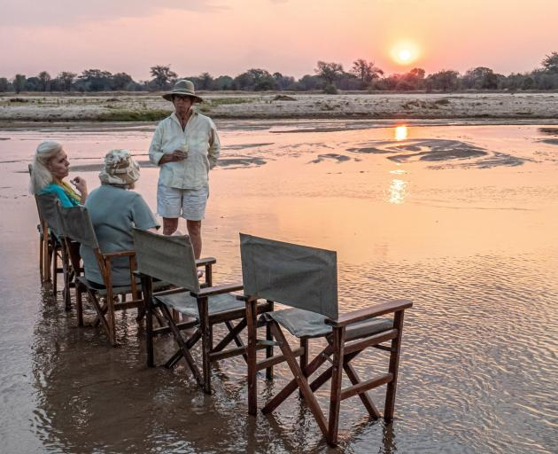 Bilimungwe manager Alex Steward has a surprise for her guests: the evening sundowner in the...