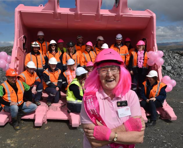 Ada Birtle, of the Palmerston Lions Club and Pink Ribbon appeal, with 22 engineers, painters and miners who squeezed into a 22-tonne digger bucket at Macraes Goldfield. Photo: Gregor Richardson