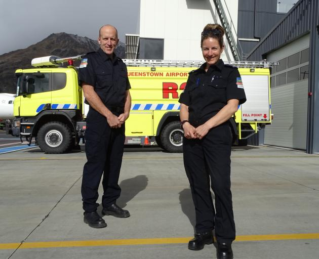 Two of Queenstown Airport's newest rescue fire graduates Gavin Mason and Aroha Hyland, who have...
