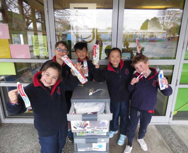 Fendalton Open-air School pupils are encouraging residents to hand over their toothbrushes and...