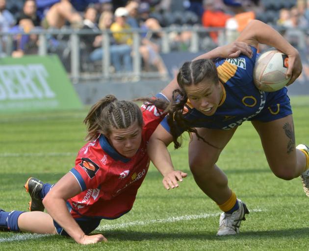 Tasman blindside flanker Tamara Silsock tries to drag down Otago second five-eighth Teilah...