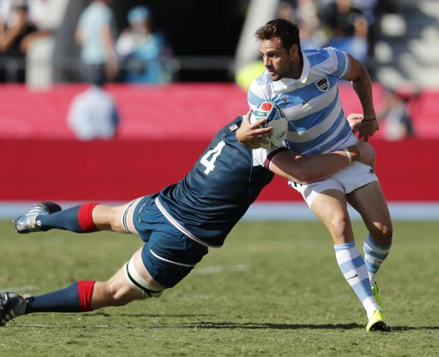 Argentina's Nicolas Sanchez in action with Nate Brakeley of the US. Photo: Reuters