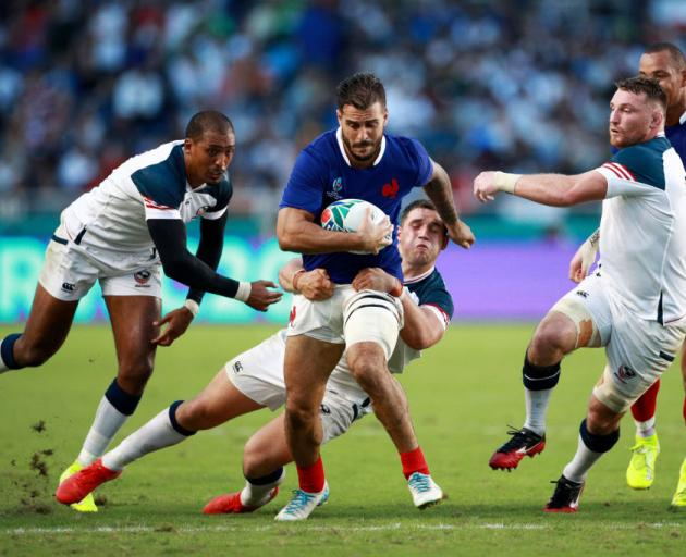 Sofiane Guitoune of France is tackled during the Rugby World Cup 2019 Group C game between France and USA. Photo: Getty Images