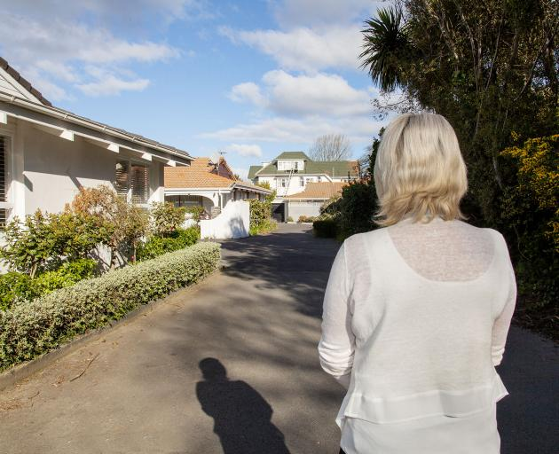 A resident looking at the properties owned by the Salisbury St Foundation. To the left is her...