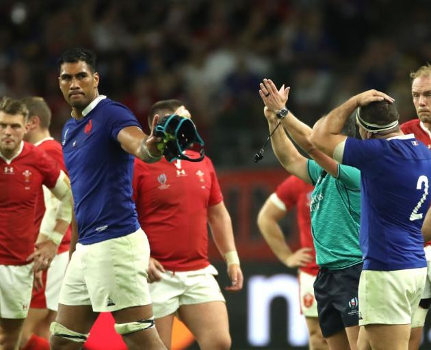 Sebastien Vahaamahina apologises to his France team mates after being red carded in Sunday's...