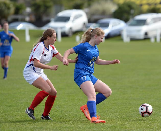 Southern United's Amy Hislop looks to control the ball against Auckland's Liz Anton at Tahuna...