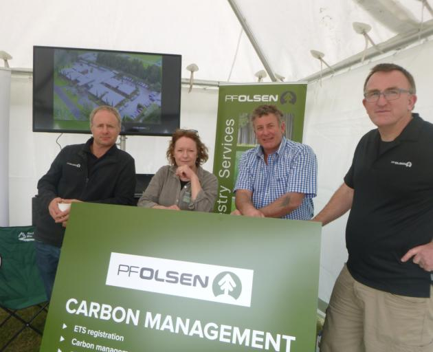 PF Olsen staff, from left, branch manager Dave Thode, business development manager Julie Hayward, harvesting manager Tim Garlick and North Island business development manager Hamish McGregor, enjoy a quieter moment at the Otago Field Days in Palmerston la