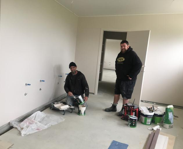 Michael Beer (left) and Nathan Kitto, of Southern Decorating, bring colour to the walls in the new toilet facilities at the Southern Field Days site in Waimumu. Photo: Alice Scott