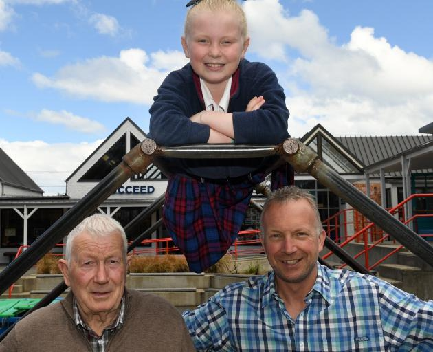 Former St Francis Xavier School pupils Tony (left) and Craig, and present pupil Lucy, are three of the four generations of the Bryant family who will celebrate the school's centenary this weekend. Photo: Stephen Jaquiery
