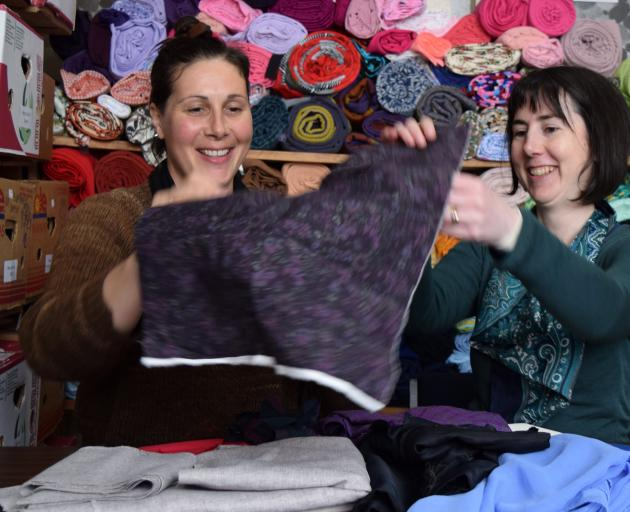Just Atelier Trust chairwoman Fiona Clements (left) and project co­ordinator Fiona Jenkin sort through pieces of donated fabric at social sewing studio Stitch Kitchen in central Dunedin. PHOTO: SHAWN MCAVINUE
