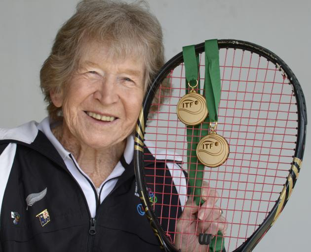 Jean Stevens shows off her two 85-and-over tennis world championship medals at the St Clair Tennis Club yesterday. Photo: Gerard O'Brien