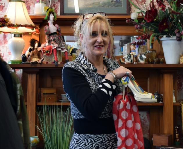 Christianne's owner Christianne Govaerts displays recycled goods for sale in her shop in Mosgiel....
