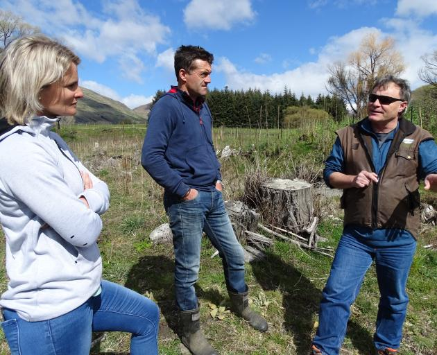 Allannah and Duncan McRae talk through future plans with Chris Arbuckle at their Fish Pond wetland.  PHOTO: KERRIE WATERWORTH