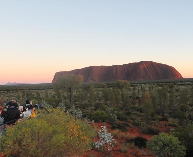View from the sunrise platform . . . crowds waiting for the sun to hit Uluru with Kata Tjuta (the Olgas) in the background. Photo: Kerrie Waterworth