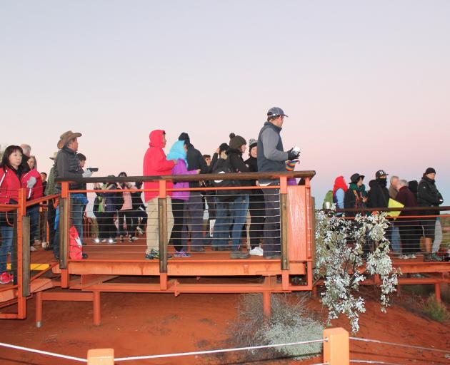 Hundreds of tourists waiting on the sunrise platform to take that early morning photo of Uluru. Photo: Kerrie Waterworth