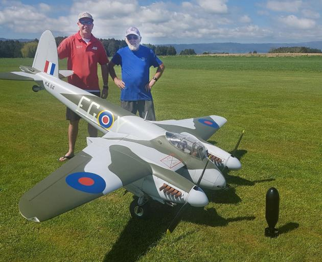 The Mosquito model aircraft will be flown at Wanaka by Frazer Briggs with his father Mike (right)...