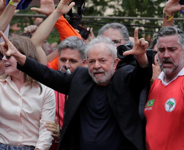 Former Brazilian President Luiz Inacio Lula da Silva arrives to deliver a speech after being...