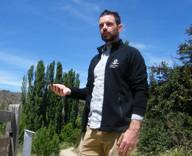 Tourism Central Otago digital marketing manager Antz Longman trials the new 360 Google Street View function at the start of the Roxburgh Gorge Trail. Photo: Adam Burns