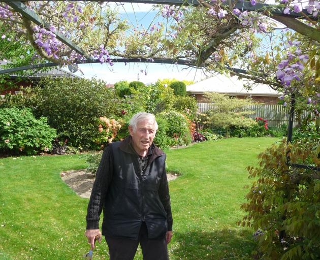 David Ford under a wisteria arch in his Tinwald garden.