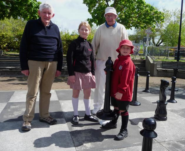 Veteran chess players Stewart Bennett, left, and Roy Keeling with Maddie and Harry Page at the...