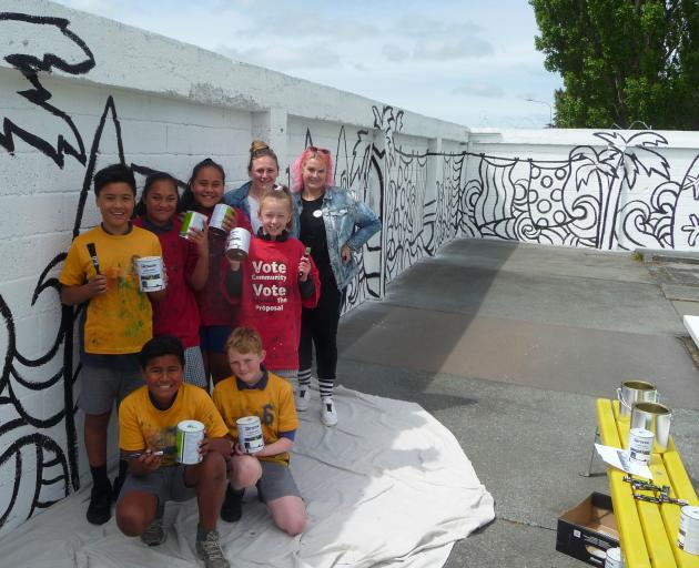 Ready to start adding colour to the mural are Hampstead School pupils Kymani Pupuke, Kalotia Ula,...