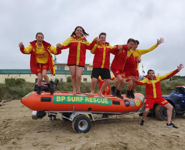 Celebrating their club's win in the BP Vote the Boat competition for a new IRB yesterday are (from left) Kaka Point surf life savers Lucy Kell, Isla Hastie, Elliott Budge, Morgan Greer and Laytun Lornie (all 15), and Daniel Haar. PHOTO: BP/SUPPLIED