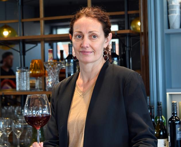 Katrina Toovey contemplates the many bottles of wine, spirits and glasses that need to be shelved before the reopening. Photos: Supplied