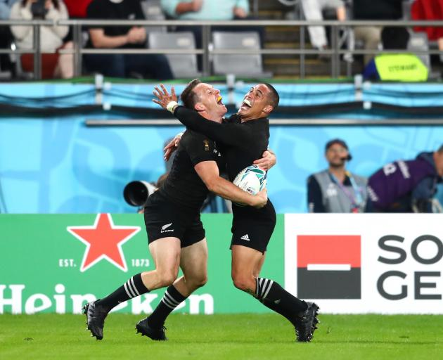 Ben and Aaron Smith celebrate Ben's second try. Photo: Getty Images