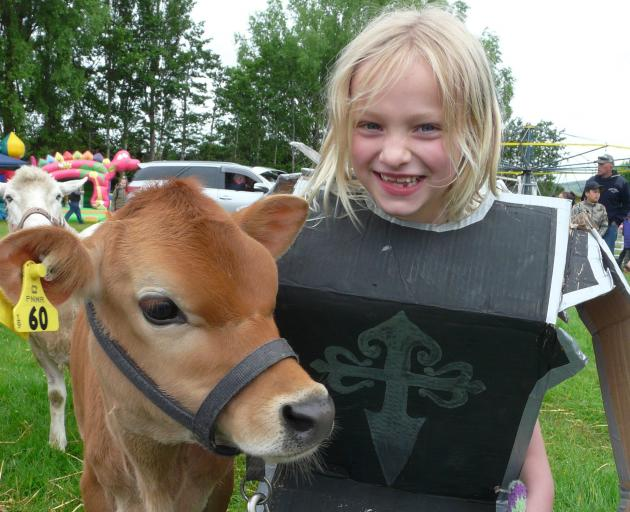 Annika Buhre (7), of Nightcaps, and Astra the calf enter the pet fancy dress competition.