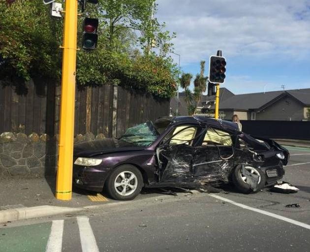 One vehicle came to a rest next to a traffic light. Photo: Rachel Das